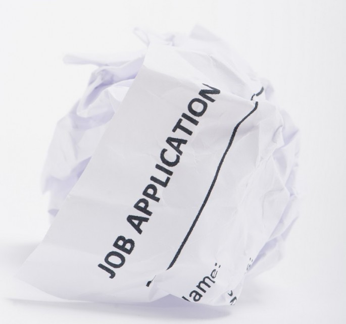 Job Application On A Crumpled Ball Of Paper
